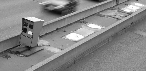 Cars passing in front of a speed control radar on the freeway